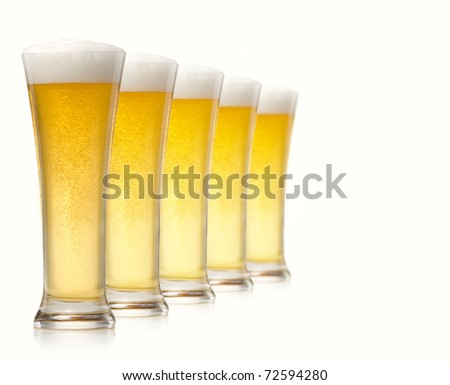 Glasses of beer isolated over white - stock photo