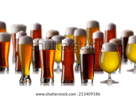 Glasses of beer with cap of foam - stock photo
