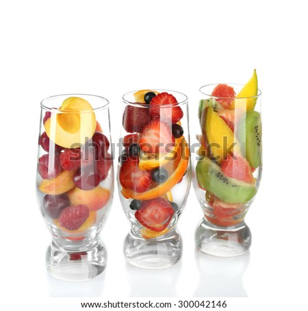 Glasses of berries and fruits isolated on white - stock photo