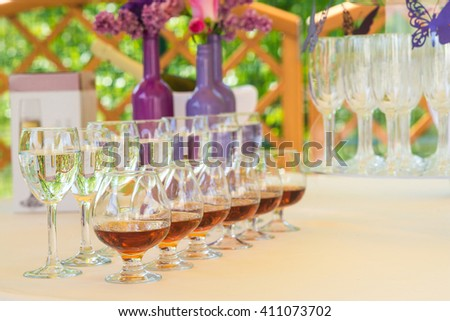 glasses of brandy and water. served table outdoor