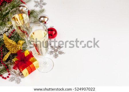 glasses of champagne and Christmas ornaments top view