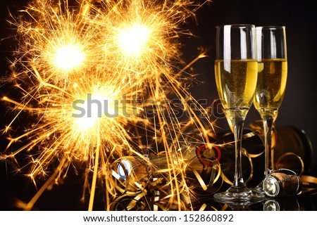 Glasses of champagne and fireworks,new year celebration. - stock photo