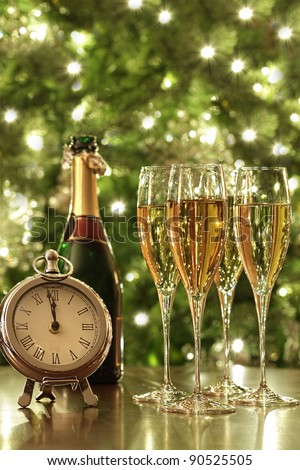 Glasses of champagne for the countdown to New Years - stock photo