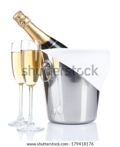 Glasses of champagne in pail, isolated on white - stock photo