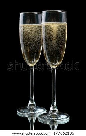 Glasses of champagne, on black background