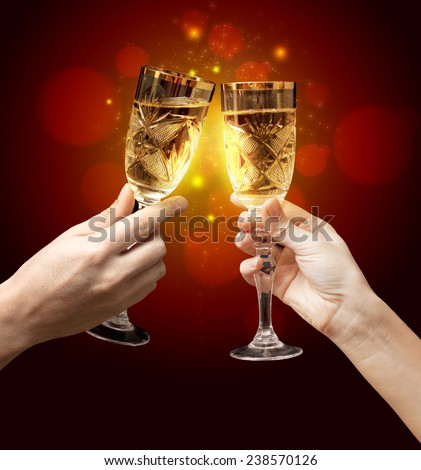 Glasses of champagne on dark background - stock photo