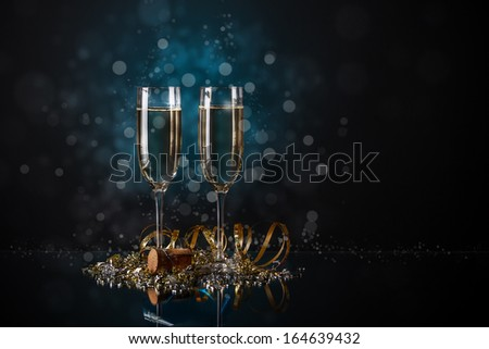Glasses of champagne on glass table - stock photo