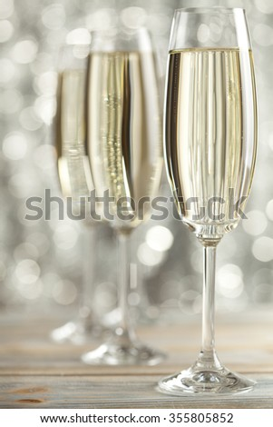 Glasses of champagne on silver background - stock photo