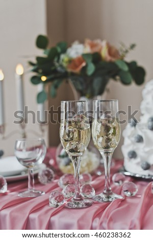 Glasses of champagne on the festive table.