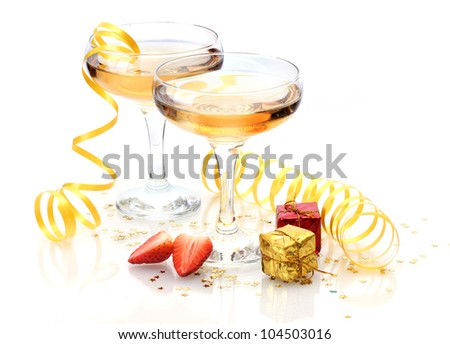 glasses of champagne, strawberries and gifts isolated on a white - stock photo