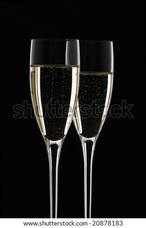 Glasses of champagne with black background - stock photo