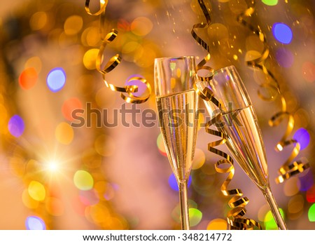 Glasses of champagne with bright gold background - stock photo