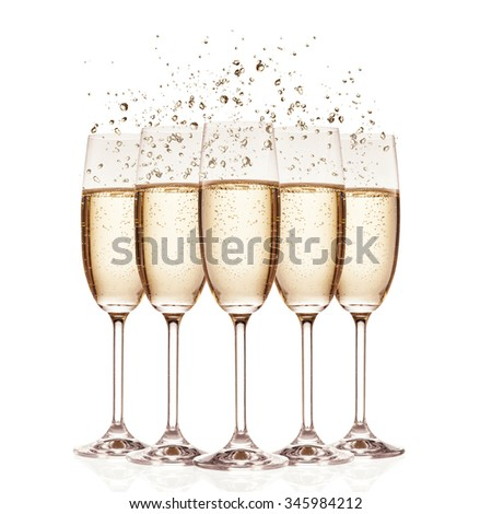 Glasses of champagne with bubbles, isolated on white background - stock photo
