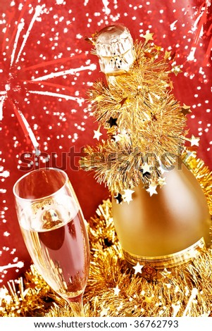 Glasses of champagne with fireworks on red background - stock photo