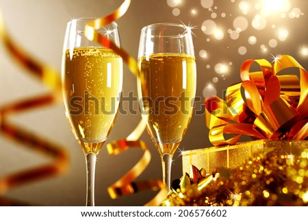 Glasses of champagne with gift box - stock photo