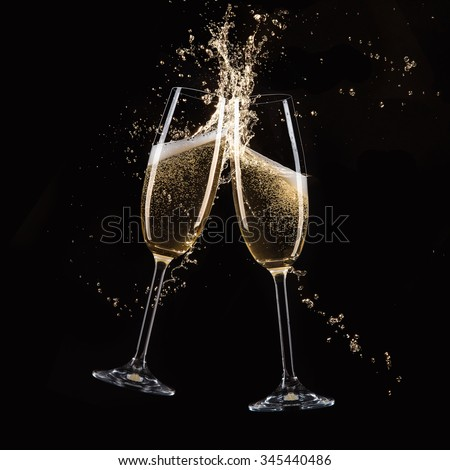 Glasses of champagne with splash - stock photo