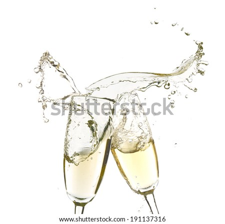 Glasses of champagne with splash, isolated on white - stock photo