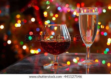 glasses of cognac and champagne on festive table - stock photo