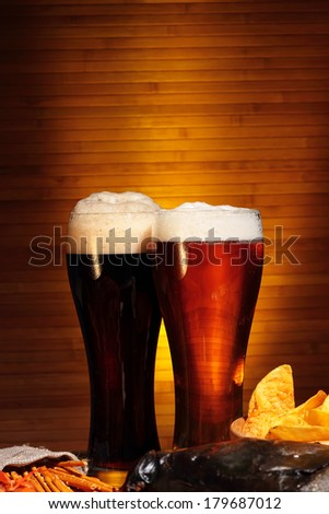 Glasses of dark and light beer close up - stock photo