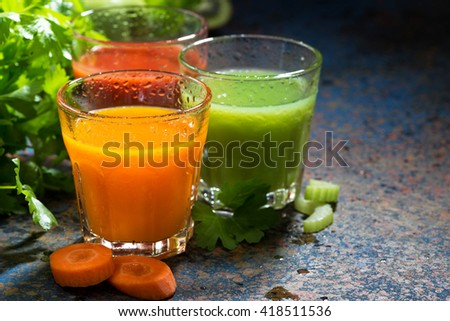 glasses of fresh vegetable juice from carrots, tomatoes and herbs, horizontal