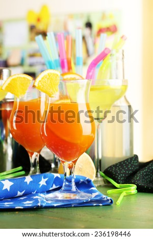 Glasses of fruit cocktails in party close-up