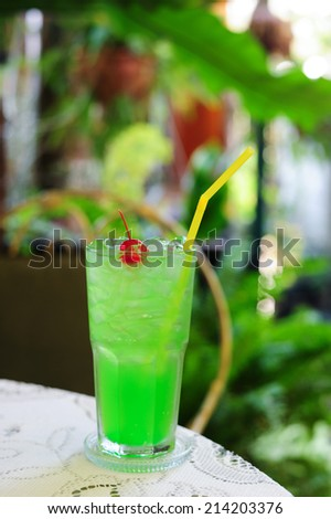 Glasses of green apple juice on table - stock photo
