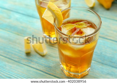 Glasses of ice lemon tea on wooden table