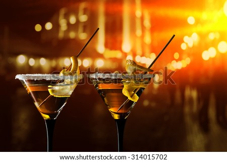 glasses of martini with lemon and sugar - stock photo