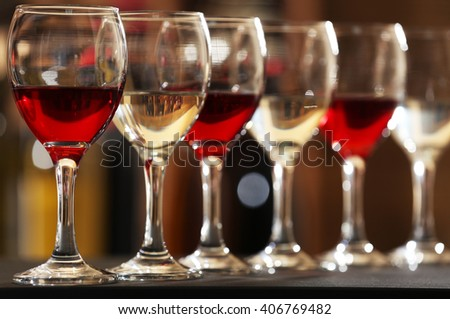Glasses of red and white wine closeup - stock photo