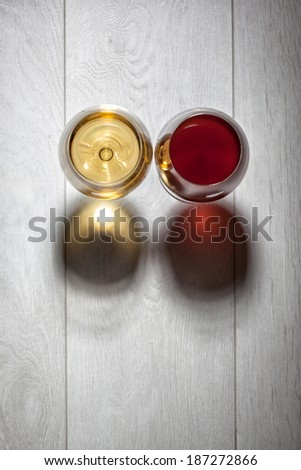 Glasses of red and white wine on wooden table. Top view - stock photo
