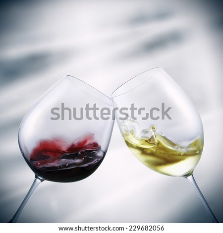 glasses of red and white wine toasting - stock photo