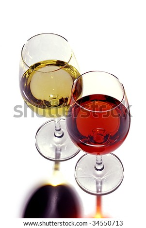 Glasses of red & white wine. - stock photo