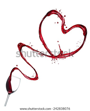 Glasses of red wine splashing out heart shape, isolated on white background - stock photo