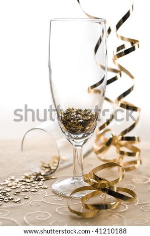 glasses of star shaped confetti with serpentine - stock photo