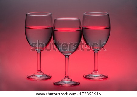 Glasses of Water on red background