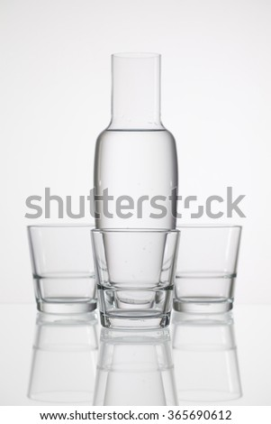 Glasses of water on the glass desk - stock photo