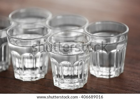 Glasses of water on wooden background - stock photo