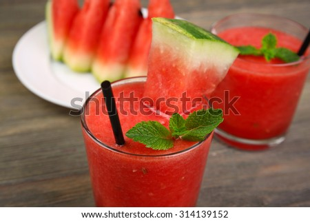 Glasses of watermelon juice on wooden table, closeup - stock photo