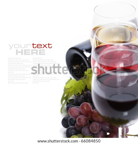 Glasses of white and rose wine and grapes over white (with sample text) - stock photo