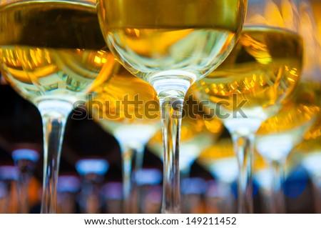 Glasses of white wine, bottom view - stock photo