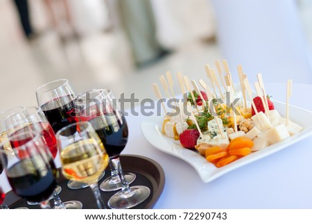 glasses of wine and snacks - stock photo