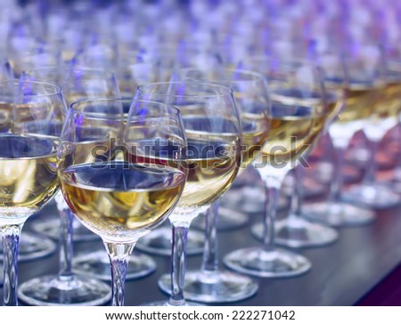 Glasses of wine at the bar. - stock photo