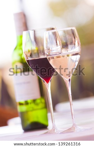 Glasses of wine with bottle - stock photo