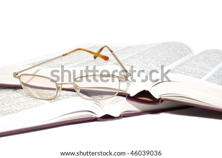 glasses on a books isolated on white