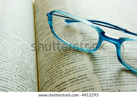 Glasses on a frech dictionary - stock photo