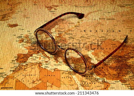 Glasses on a map of a world  - stock photo