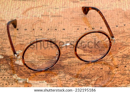 Glasses on a map of a world - Russia  - stock photo