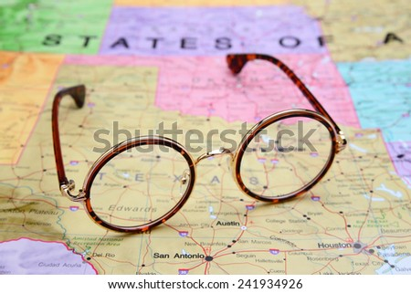 Glasses on a map of USA - Texas  - stock photo