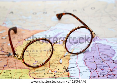 Glasses on a map of USA - Wisconsin