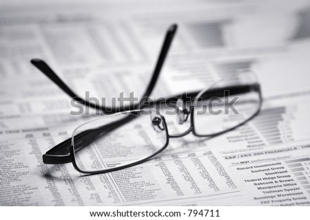 Glasses on a newspaper. Black and white - stock photo